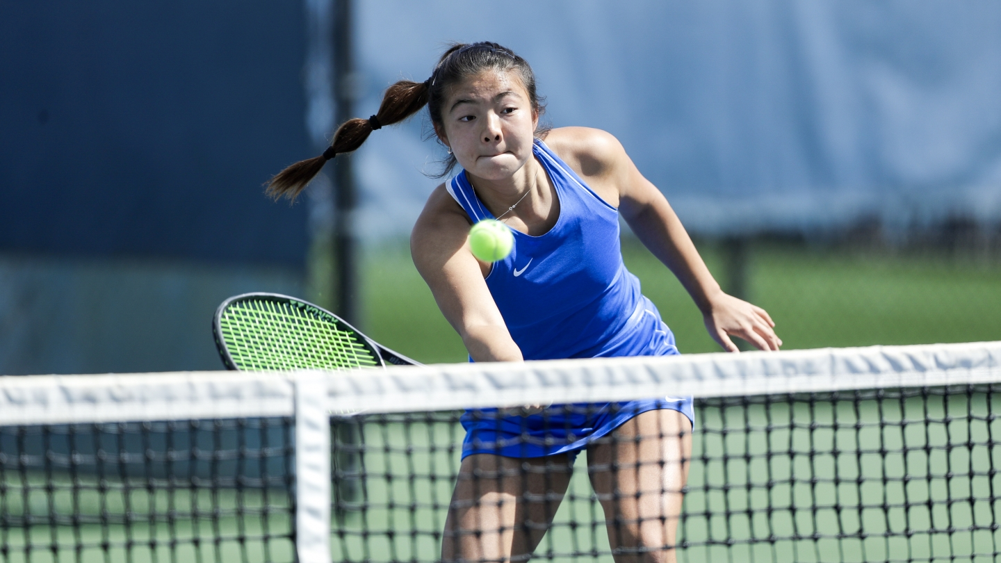 Helen Jiao hits at the net against Pepperdine
