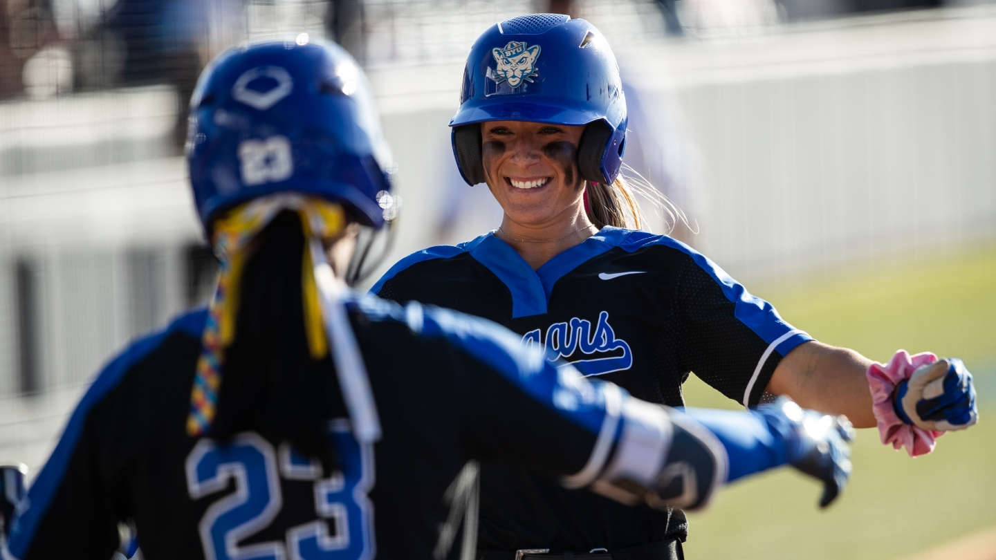 HannahJo Peterson and Violet Zavodnik celebrate at home plate against Baylor