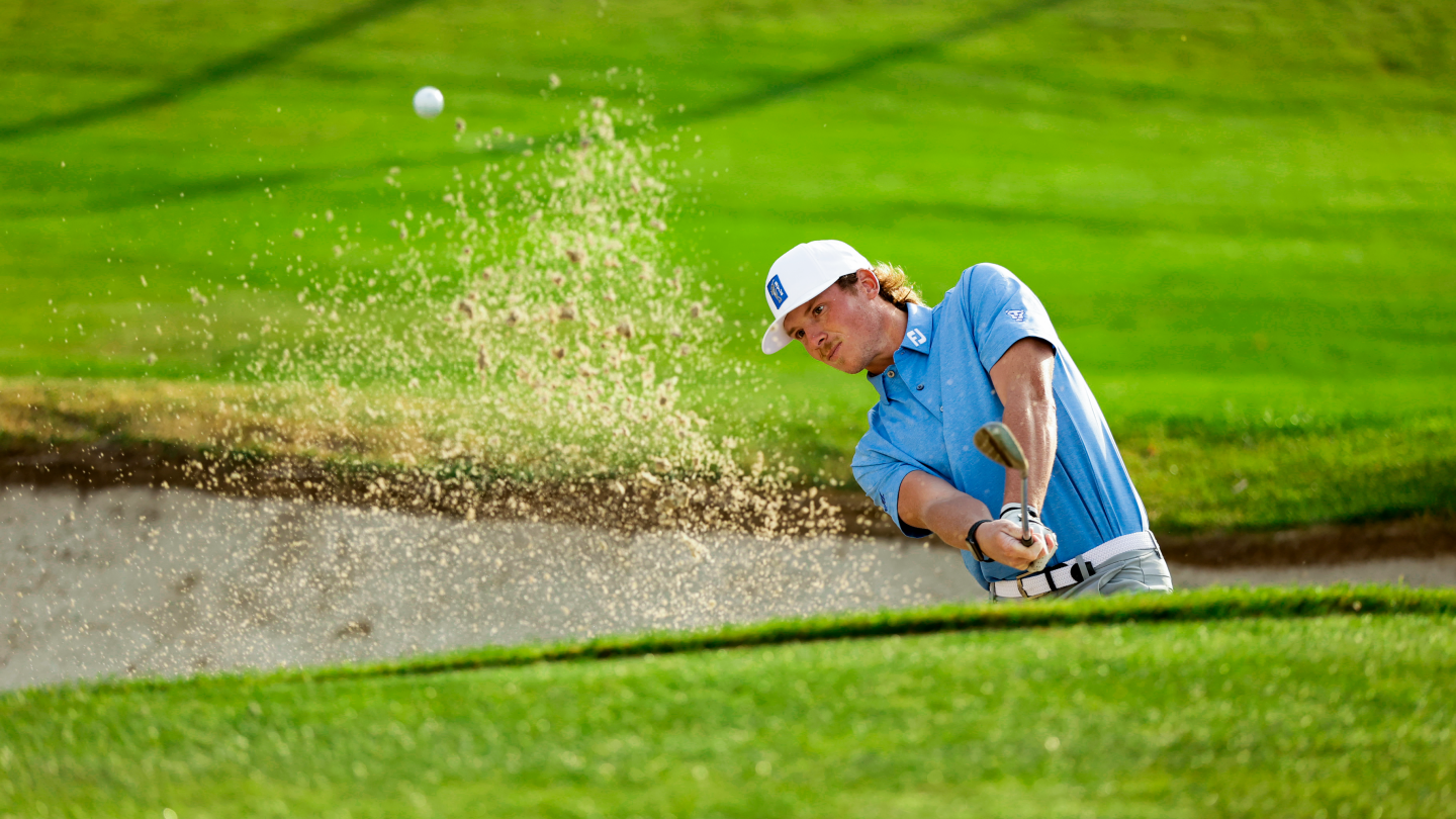 BYU golfer Carson Lundell hits a shot out of a bunker at Riverside Country Club.