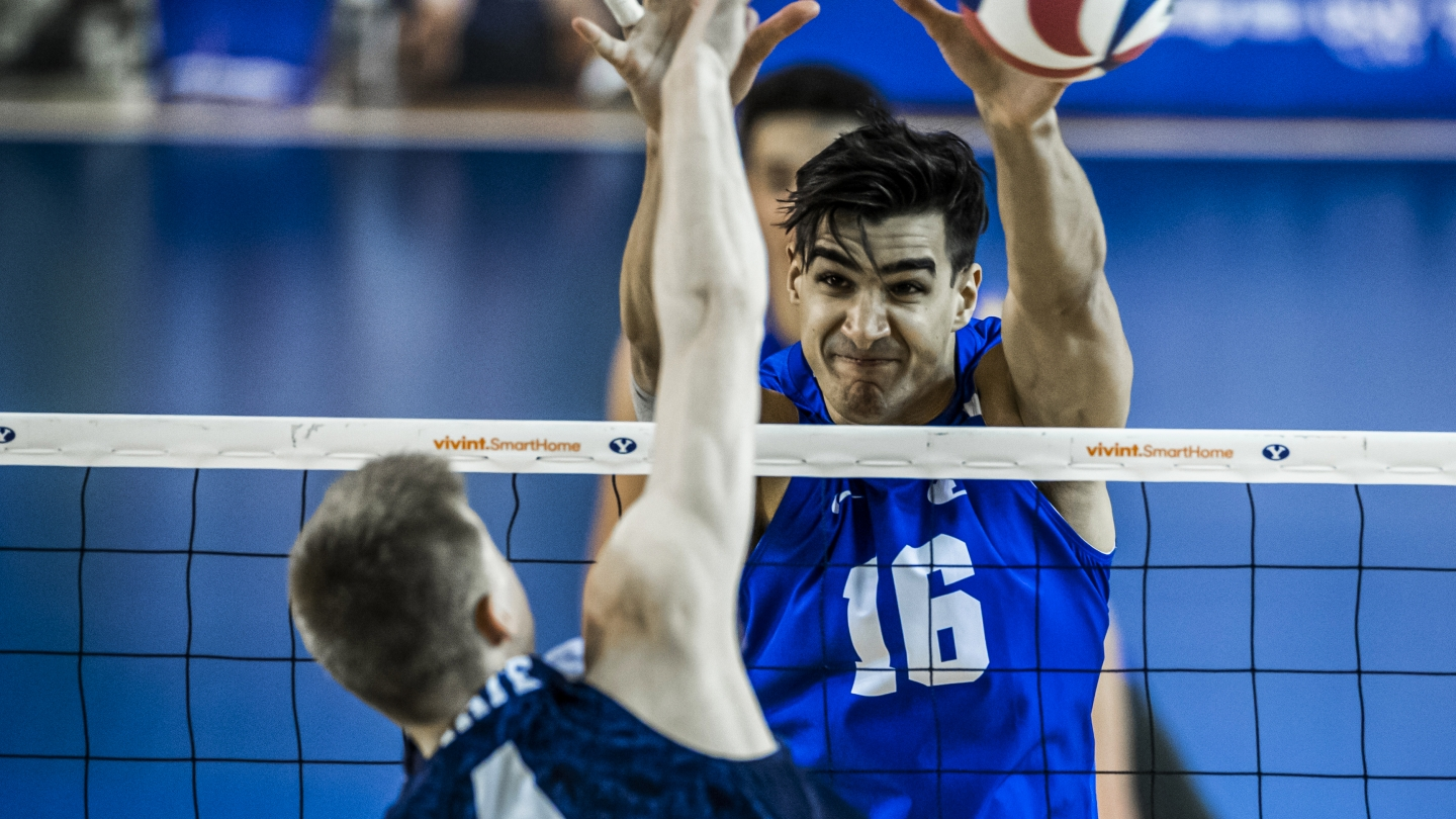 Felipe de Brito Ferreira blocks an attack for BYU men's volleyball against Penn State