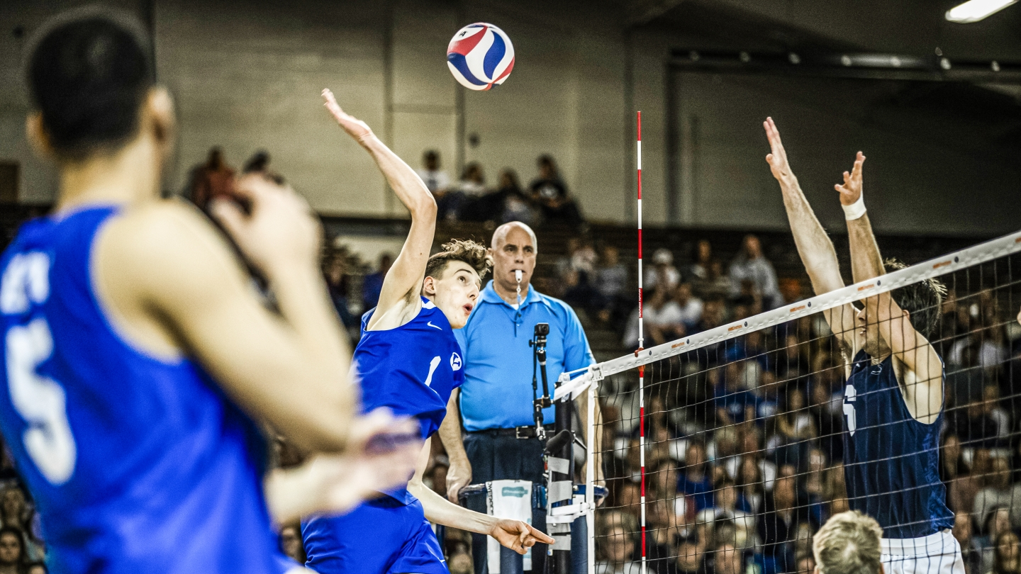 Davide Gardini attacks the ball in BYU men's volleyball match