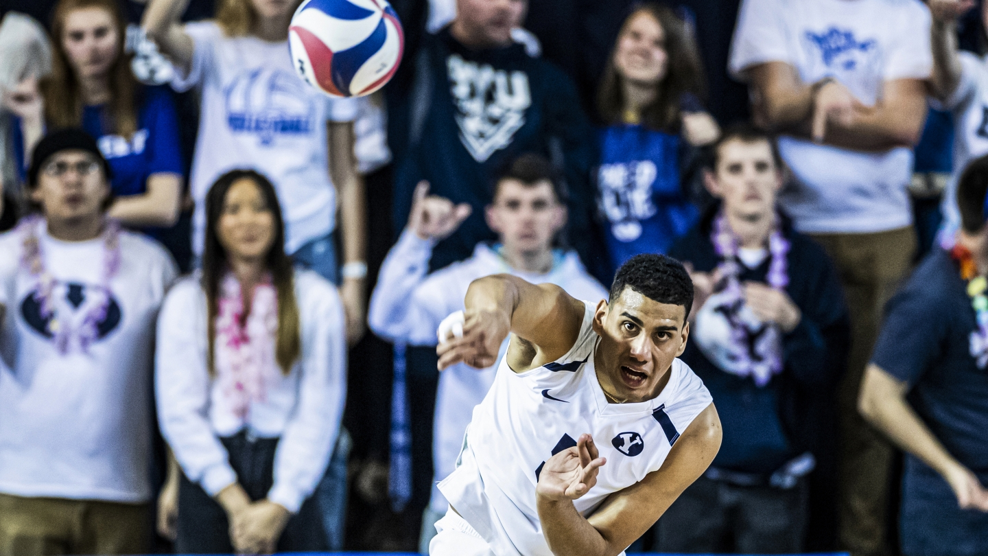 Gabi Garcia Fernandez serves the ball at BYU men's volleyball match in the Smith Fieldhouse