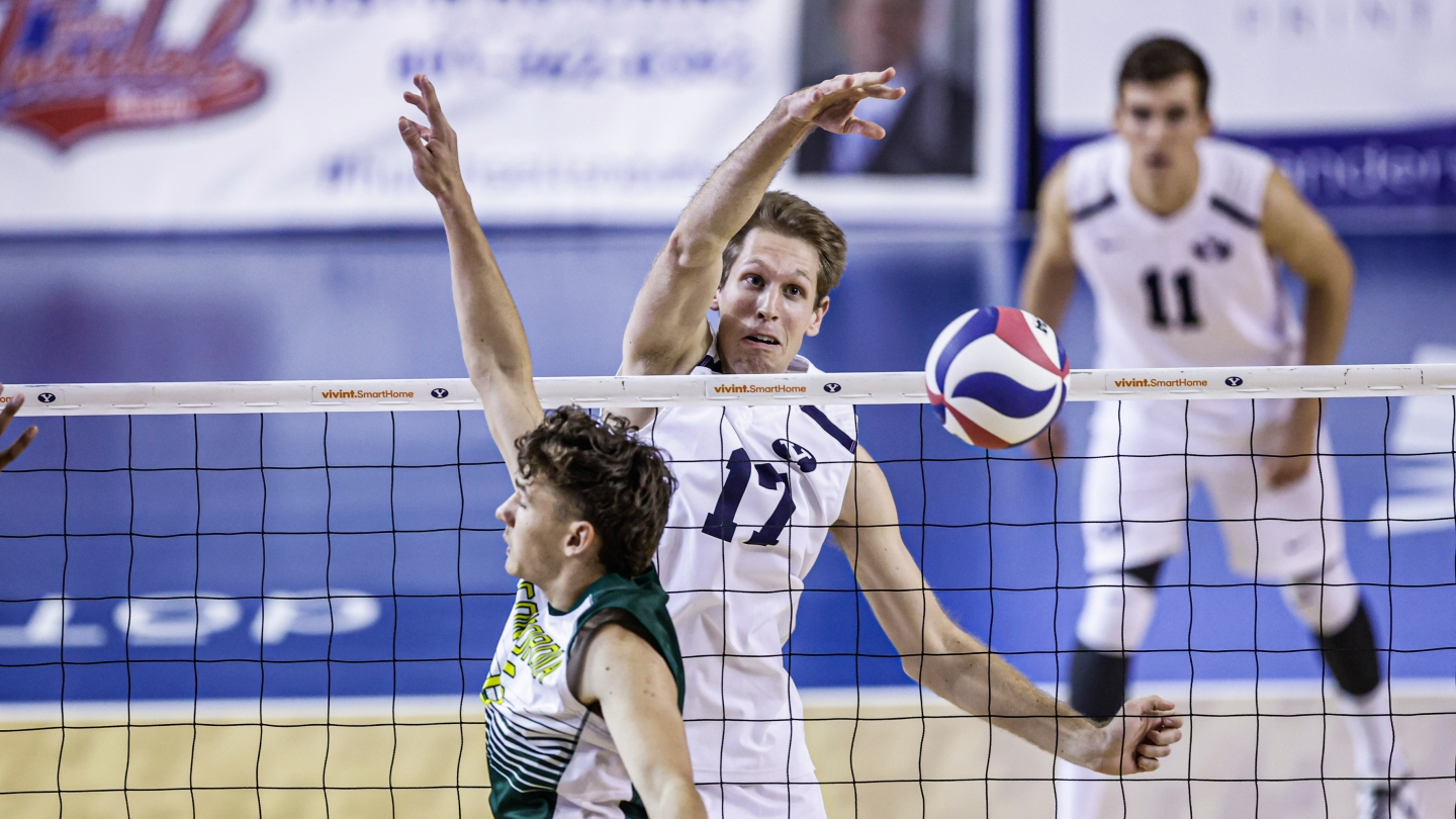 Branden Oberender spikes the ball for BYU men's volleyball